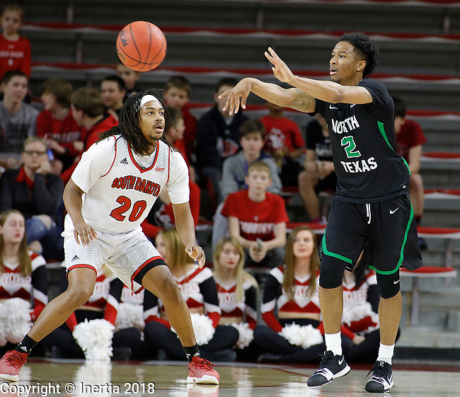 VERMILLION, SD: MARCH 14:  Jorden Duffy #2 of North Texas passes around South Dakota defender Brandon Armstrong #20 during the 2018 CBI Basketball Tournament at the Sanford Coyote Sports Center in Vermillion, S.D.  (Photo by DIck Carlson/Inertia)