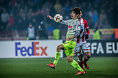 7th December 2017, Rajko Mitic Stadium, Belgrade, Serbia, UEFA Europa League football, Red Star Belgrade versus FC Cologne;  Forward Yuya Osako of FC Koeln controls the high ball