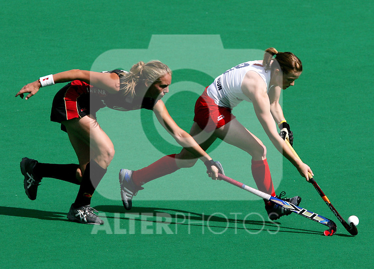 England's Helen Richardson challenged by Germany Fanny  Rinne during Samsung Women's World Cup Hockey Pool A match between Germany and England at Club de Campo in Madrid, Tuesday 03 October, 2006. (ALTERPHOTOS/Alvaro Hernandez).