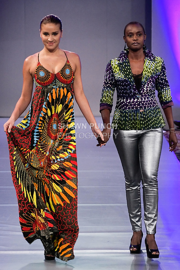 Nigeria born fashion designer Eredappa Hart, walks runway with a model at the close of her Eredappa Spring Summer 2012 fashion show, during Couture Fashion Week Spring 2012.