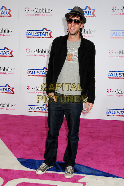 JOEL DAVID MOORE .T-Mobile Magenta Carpet at the 2011 NBA All-Star Game held at LA Live, Los Angeles, California, USA..February 20th, 2011.full length jacket jeans denim top black hat sunglasses shades grey gray stubble facial hair.CAP/ADM/BP.©Byron Purvis/AdMedia/Capital Pictures.