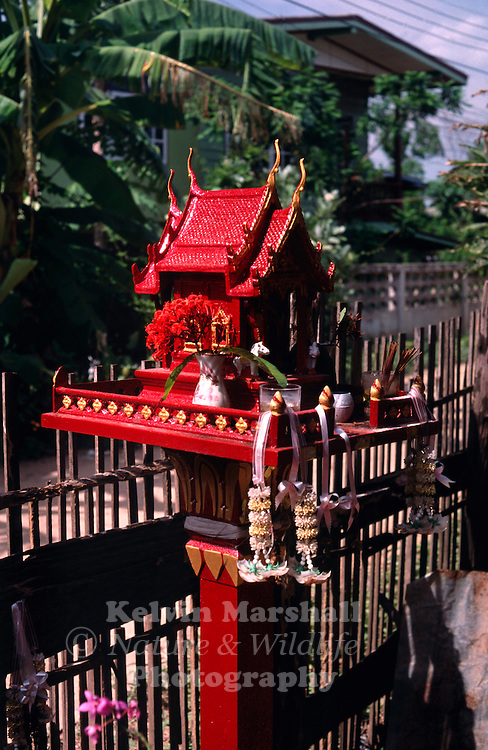 A spirit house is a shrine to the protective spirit of a place that are found in the Southeast Asian countries of Burma, Cambodia, Laos, and Thailand. Most houses and businesses have a spirit house placed in an auspicious spot, most often in a corner of the property. The house is intended to provide a shelter for spirits which could cause problems for the people if not appeased. Chiang Mai - Northern Thailand.