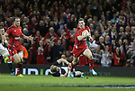 Wales wing leaves Scotland lock Richie Gray trailing as he runs over to score.<br /> RBS 6 Nations 2014<br /> Wales v Scotland<br /> Millennium Stadium<br /> <br /> 15.03.14<br /> <br /> ©Steve Pope-SPORTINGWALES