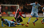 Leon Clarke of Sheffield Utd underneath Marc Wilson of Sunderland  during the Championship match at Bramall Lane Stadium, Sheffield. Picture date 26th December 2017. Picture credit should read: Simon Bellis/Sportimage