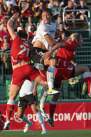 Abby Wambach of the magicJack wins the ball away from Brittany Bock and Becky Edwards of the Western New York Flash. The Western New York Flash defeated the magicJack 3-0 in Women's Professional Soccer (WPS) at Sahlen's Stadium in Rochester, NY on May, 22 2011.