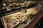 "A view inside the display case of Whisker Bones shows doggie donuts, a birthday cake shaped like a bone, cookies, and ""pupcakes""."