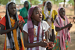 Girls sing a song as they participate in an activity sponsored by Jesuit Refugee Service in the Doro Refugee Camp in Maban, South Sudan. The camp is one of four in Maban that together shelter more than 130,000 refugees from the Blue Nile region of Sudan.<br /> <br /> Misean Cara supports the work of JRS in the Maban camps.
