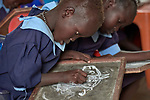 Children draw on chalkboard tablets in a primary school in Bunj, South Sudan, sponsored by Jesuit Relief Service. The community is host to more than 130,000 refugees from the Blue Nile region of Sudan, and JRS, with support from Misean Cara, provides educational and psycho-social services to both refugees and the host community.