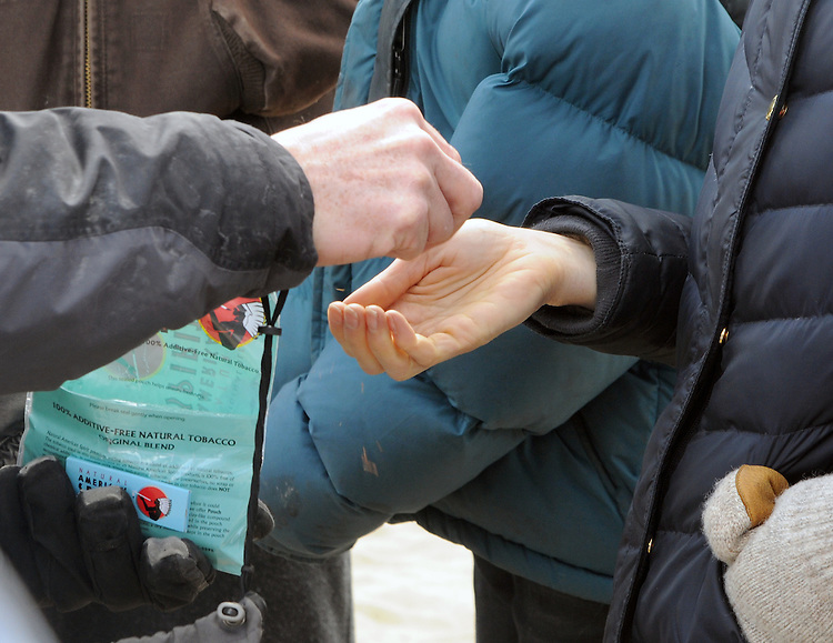 Detail photo of the distribution of samples of loose tobacco to the participants at a Association of Native American of the Hudson Valley, sponsored Native American Water Blessing Ceremony held for the Hudson River at Kingston Point Beach in Kingston, NY, on Saturday, March 4, 2017. Photo by Jim Peppler; Copyright Jim Peppler 2017