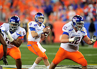 Jan. 4, 2010; Glendale, AZ, USA; Boise State Broncos quarterback (11) Kellen Moore against the TCU Horned Frogs in the 2010 Fiesta Bowl at University of Phoenix Stadium. Boise State defeated TCU 17-10. Mandatory Credit: Mark J. Rebilas-