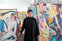 Elvira Bach, a German artist with some of her paintings in her studio in a former factory building in the Kreuzberg district of Berlin..