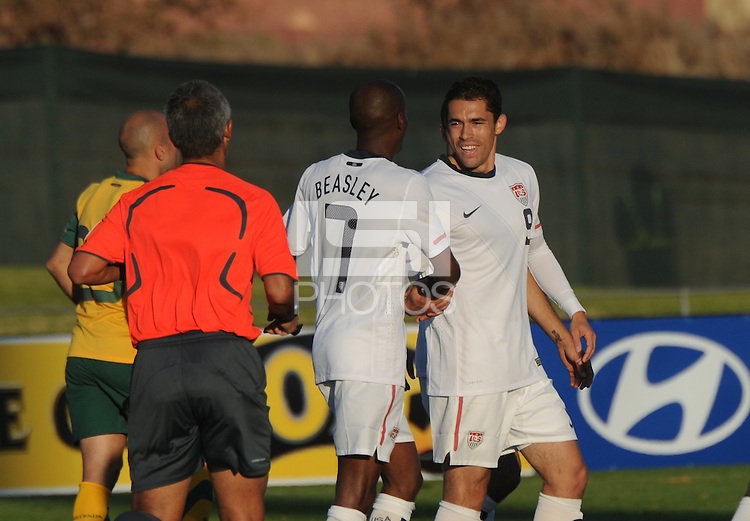 American forward Hercules Gomez receives congratulations from DaMarcus Beasley on the final U.S. goal, coming in the third minute of stoppage time. The U.S. won the match over Australia, 3-1, played June 5th, in Ruimsig Stadium,  at Roodepoort, South Africa.