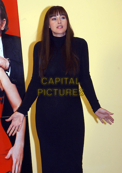 "MONICA BELLUCCI.Press conference for her new film ""For Sex Or Love?"" (Per Sesso O Per Amore) in Rome, Italy..January 25th, 2006.Ref: OME                      .half length black dress hands.www.capitalpictures.com.sales@capitalpictures.com.© Capital Pictures."