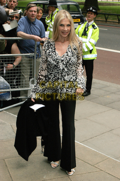 Singer / songwriter Lynsey De Paul has died at the age 64 following suspected brain haemorrhage. She represented the UK in the 1977 Eurovision Song Contest and was best known for her hits Sugar Me and Won't Somebody Dance With Me.<br /> STOCK PHOTO: LYNSEY DE PAUL<br /> Arrivals at the Ivor Novello Awards, Grosvenor House, London, England.<br /> May 24th, 2007<br /> full length black trousers white monochrome top lindsay lindsey <br /> CAP/AH<br /> &copy;Adam Houghton/Capital Pictures