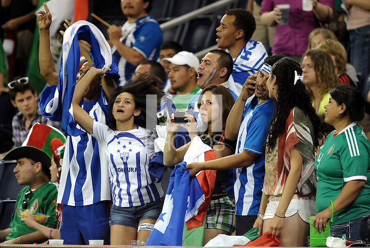 Honduras and Mexico fans mix together... Mexico defeated Honduras 2-1 after extra time to win the CONCACAF Olympic qualifying trophy at LIVESTRONG Sporting Park, Kansas City, Kansas.