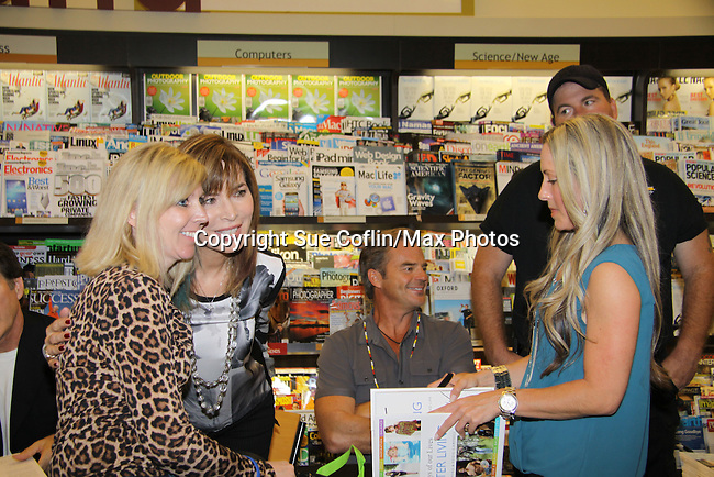 """Days Of Our Lives - Wally Kurth, Lauren Koslow and fans meet the fans as they sign """"Days Of Our Lives Better Living"""" on September 27, 2013 at Books-A-Million in Nashville, Tennessee. (Photo by Sue Coflin/Max Photos)"""