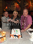 William Mahony, Sarah Lynch and Mayor of Drogheda Frank Godfrey cut a cake to celebrate the third birthday of Louth Family  Carers Support Group in The d Hotel. Photo:Colin Bell/pressphotos.ie