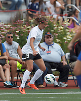 Portland Thorns FC forward Danielle Foxhoven (9) controls the ball. In a National Women's Soccer League (NWSL) match, Portland Thorns FC (white/black) defeated Boston Breakers (blue), 2-1, at Dilboy Stadium on July 21, 2013.