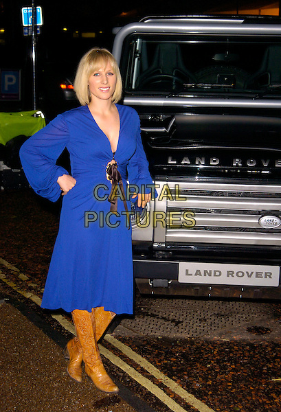 ZARA PHILLIPS.The Red Cross London Ball, The Room By The River, London, England..November 21st, 2007.full length philips blue dress black ribbon belt brown cowboy boots hand on hip car land rover .CAP/CAN.©Can Nguyen/Capital Pictures