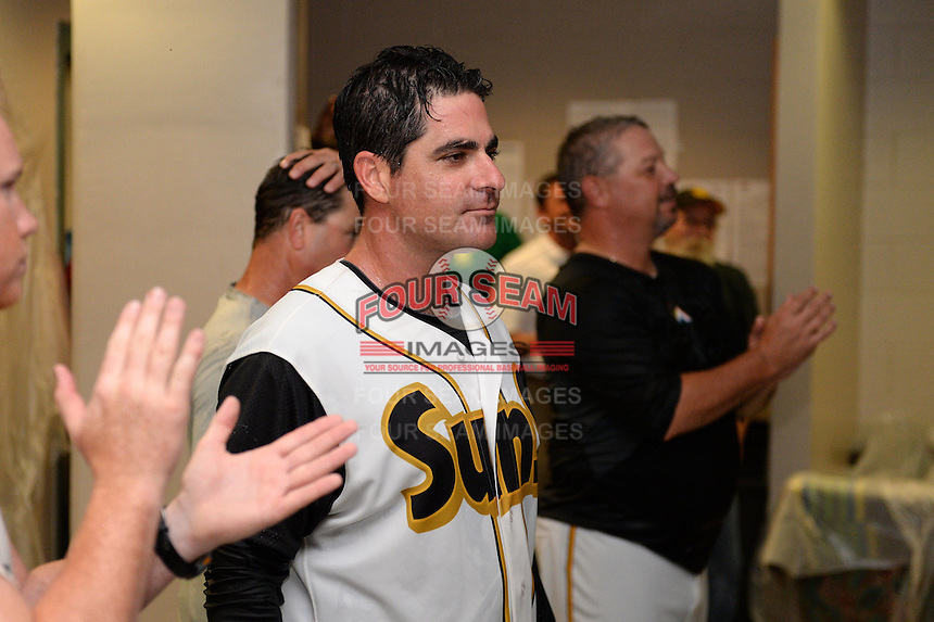 Jacksonville Suns manager Andy Barkett (17) addresses his team after game three of the Southern League Championship Series against the Chattanooga Lookouts on September 12, 2014 at Bragan Field in Jacksonville, Florida.  Jacksonville defeated Chattanooga 6-1 to sweep three games to none.  (Mike Janes/Four Seam Images)