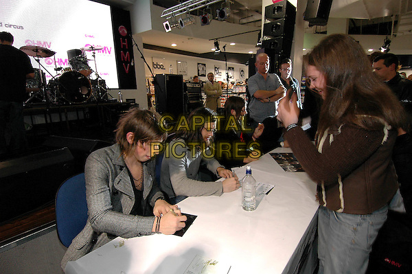 KINGS OF LEON - MATTHEW & NATHAN FOLLOWILL.HMV Oxford Street.November 1st, 2004.half length, signing autographs, fans,.www.capitalpictures.com.sales@capitalpictures.com.©Capital Pictures