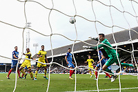 Josh Ruffels of Oxford United (left) scores his team's first goal of the game to make the score 1-1 during the Sky Bet League 1 match between Peterborough and Oxford United at the ABAX Stadium, London Road, Peterborough, England on 30 September 2017. Photo by David Horn.