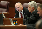 Nevada Assembly Republicans Ira Hansen, left, and Erven Nelson work on the Assembly floor at the Legislative Building in Carson City, Nev., on Wednesday, May 13, 2015. Assemblyman Mike Sprinkle, D-Sparks, is at far right.<br /> Photo by Cathleen Allison