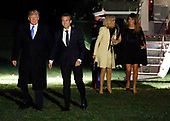 United States President Donald J. Trump and Melania Trump return to the South Lawn with President Emmanuel Macron of France and his wife, Brigitte Macron, following dinner at Mount Vernon, in Washington, DC on April 23, 2018. <br /> Credit: Martin H. Simon / CNP