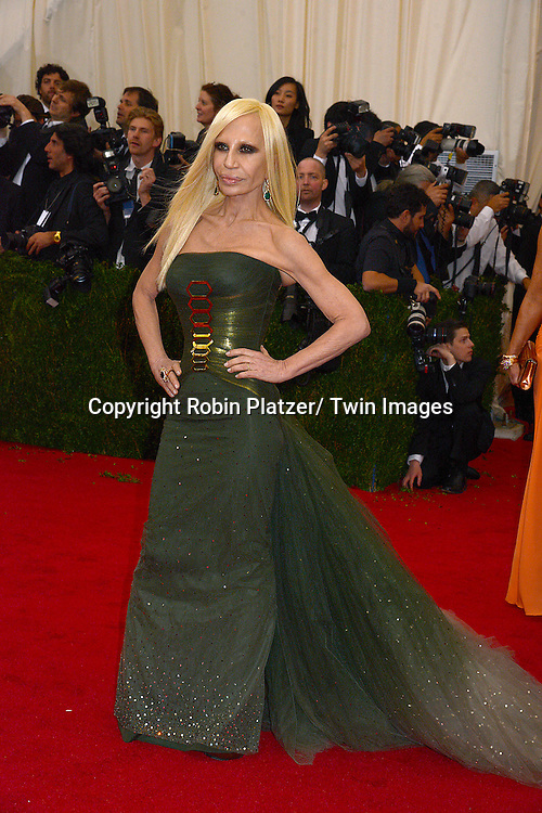 Donatella Versace attends the Costume Institute Benefit on May 5, 2014 at the Metropolitan Museum of Art in New York City, NY, USA. The gala celebrated the opening of Charles James: Beyond Fashion and the new Anna Wintour Costume Center.