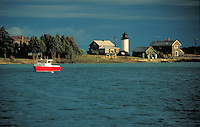 boat in the harbor near lighthouse, coastal landscape. Beaver Island Michigan USA.