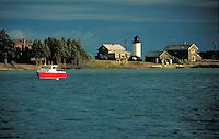 boat in the harbor near lighthouse, coastal landscape. Beaver Island Michigan USA.