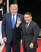 President Khaltmaa Battulga of Mongolia, right, waves to the press as he and United States President Donald J. Trump, left, participate in the arrival at the South Portico of the White House in Washington, DC on Wednesday, July 31, 2019.<br /> Credit: Ron Sachs / CNP