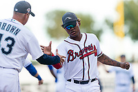 AFL West center fielder Cristian Pache (27), of the Peoria Javelinas and Atlanta Braves organization, prepares to shake hands with manager Daren Brown (43) during player introductions before the Arizona Fall League Fall Stars game at Surprise Stadium on November 3, 2018 in Surprise, Arizona. The AFL West defeated the AFL East 7-6 . (Zachary Lucy/Four Seam Images)