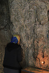 A prayer by the rock at the Greek Orthodox Quarantal Monastery on the Mount of Temptation, Jericho