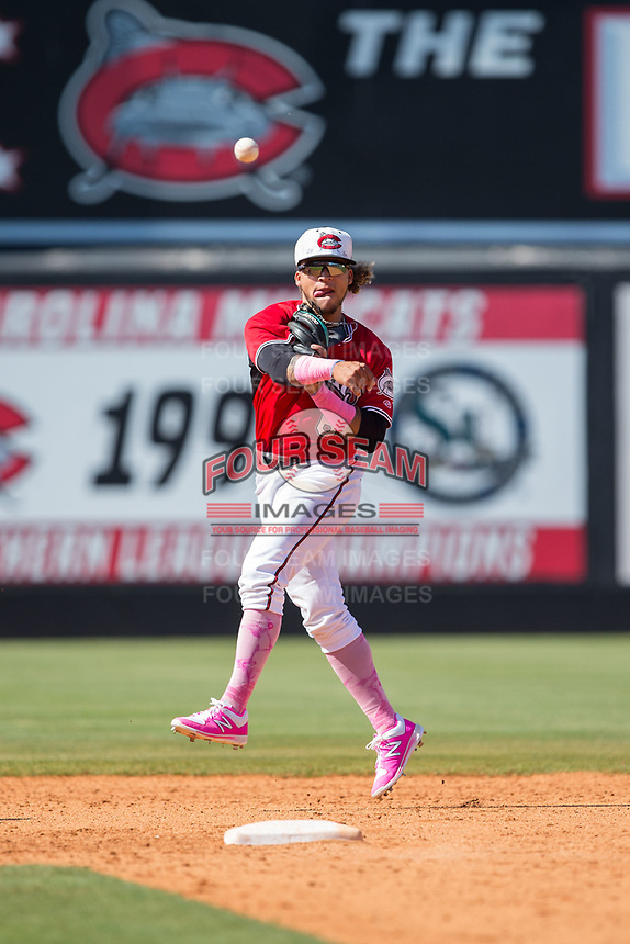 Carolina Mudcats second baseman Isan Diaz (6) makes a throw to first base against the Winston-Salem Dash at Five County Stadium on May 14, 2017 in Zebulon, North Carolina.  The Mudcats walked-off the Dash 11-10.  (Brian Westerholt/Four Seam Images)