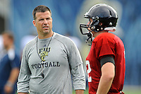 7 August 2011:  FIU Head Coach Mario Cristobal speaks with Quarterback Jake Medlock (12) after the first day of fall practice with full pads at University Park Stadium in Miami, Florida.
