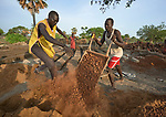 Local community members prepare construction materials at the Loreto School in Rumbek, South Sudan. The school is run by the Institute for the Blessed Virgin Mary--the Loreto Sisters--of Ireland.