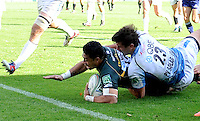 Northampton, England. George Pisi of Northampton Saints scores a try during the Heineken Cup Pool 4 match between Northampton Saints and Glasgow Warriors at Franklin's Gardens on October 14, 2012 in Northampton, England.