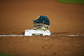 Siena Saints hat and glove sit on third base in between innings during a game against the UCF Knights on February 17, 2017 at UCF Baseball Complex in Orlando, Florida.  UCF defeated Siena 17-6.  (Mike Janes/Four Seam Images)