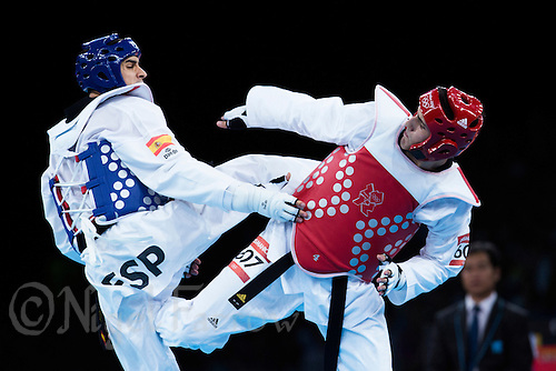 10 AUG 2012 - LONDON, GBR - Sebastian Crismanich (ARG) (right) of Argentina and Nicolas Garcia Hemme (ESP) (left) of Spain trade kicks during the men's -80kg category final at the London 2012 Olympic Games Taekwondo at Excel in London, Great Britain .(PHOTO (C) 2012 NIGEL FARROW)
