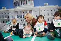 Environmental activist Erin Brockovich pose with toddlers in Madison Square Park in New York on Wednesday, November 18, 2009 to  promote the Million Baby Crawl. The Million Baby Crawl is an effort to overhaul the toxic chemical policies by providing stronger laws and more oversight over what is put into consumer products. The campaign's goal is to raise awareness and support for the Kid-Safe Chemical Act which will be presented to Congress in December. It would require industrial chemicals to be safe for infants, new chemicals to be safety tested prior to being put into products, and existing untested chemicals in use would be tested for safety. (© Richard b. Levine)