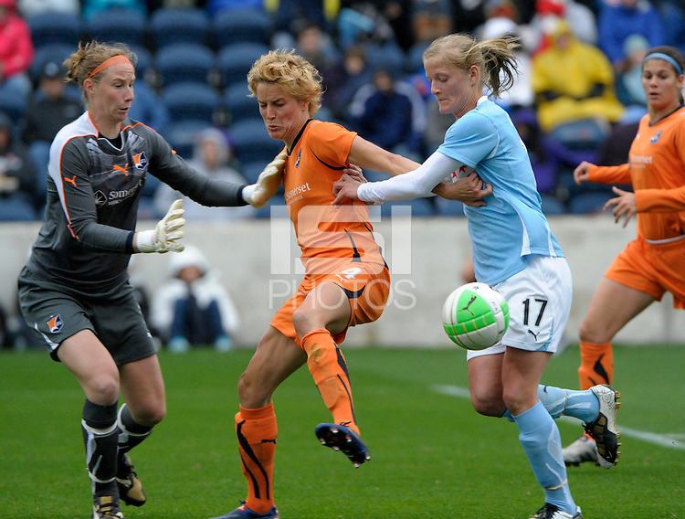 Sky Blue defender Daphne Koster (4) shields the ball from Chicago midfielder Katie Chapman (17) while Sky Blue goalkeeper Karen Bardsley (1) tries to make the save.  Sky Blue FC defeated the Chicago Red Stars 1-0 at Toyota Park in Bridgeview, IL on April 25, 2010.