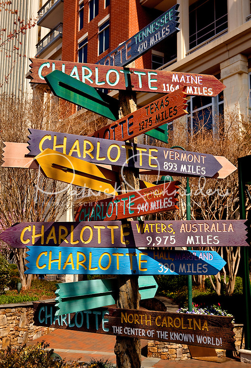 The Charlotte streetsign sculpture points visitors every which way from its location on The Green in downtown Charlotte, NC. The Green is a 1.5-acre urban park in the heart of Charlotte.