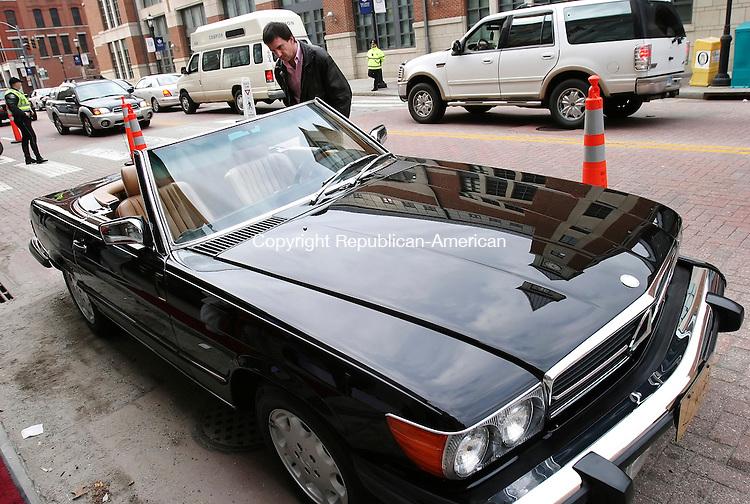 WATERBURY, CT 03/14/08- 031408BZ01- Paul Hufcut, of Bridgeport, looks at the interior of a 1986 Mercedes 560 SL being auctioned off during a  fundraiser for the Palace Theater Friday night.  The car, once owned by &quot;Star Wars&quot; director George Lucas, was donated by a friend of the Palace.<br /> Jamison C. Bazinet Republican-American