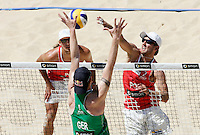 Campionati mondiali di beach volley, Roma, 18 giugno 2011..Germany's Julius Brink, back to camera, walls against Poland's Grzegorz Fijalek, right, and Mariusz Prudel, during the Beach Volleyball World Championship in Rome, 18 june 2011..UPDATE IMAGES PRESS/Riccardo De Luca