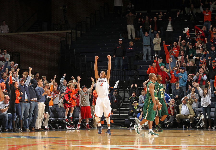 Dec. 20, 2010; Charlottesville, VA, USA; Virginia Cavaliers guard Mustapha Farrakhan (2) raises his hands in the air after narrowing winning the game 50-49 against the Norfolk State Spartans at the John Paul Jones Arena. Virginia won 50-49. Mandatory Credit: Andrew Shurtleff