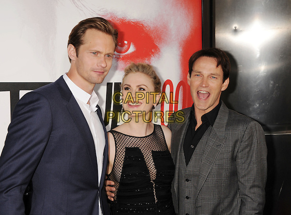 "Alexander Skarsgard, Anna Paquin, Stephen Moyer.HBO's ""True Blood"" Season 5 Premiere, Hollywood, California, USA..May 30th, 2012.half length black dress sheer polka dot sleeveless grey gray suit married husband wife pregnant blue looking up mouth open smiling .CAP/ROT/TM.©Tony Michaels/Roth Stock/Capital Pictures"