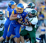 BROOKINGS, SD - SEPTEMBER 6:  Zach Zenner #31 from South Dakota State University is wrapped up by Nick Dzubnar #41 from Cal Poly in the first half of their game Saturday evening at Coughlin Alumni Stadium in Brookings.(Photo/Dave Eggen/Inertia)