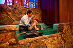 Associate Pastor Nathan Winters baptizes Casey Robbins who departs for the Air Force the following day during the service at First Baptist Church in Thermopolis, Wyoming August 21, 2011.2