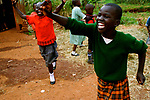 Rose celebrates after scoring a goal in a game of ultimate frisbee at Hamomi Children's Centre in Nairobi, Kenya